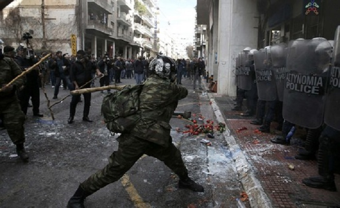 Greek farmers from the region of Crete clash with police during a protest against planned pension reforms outside the Agriculture ministry in Athens