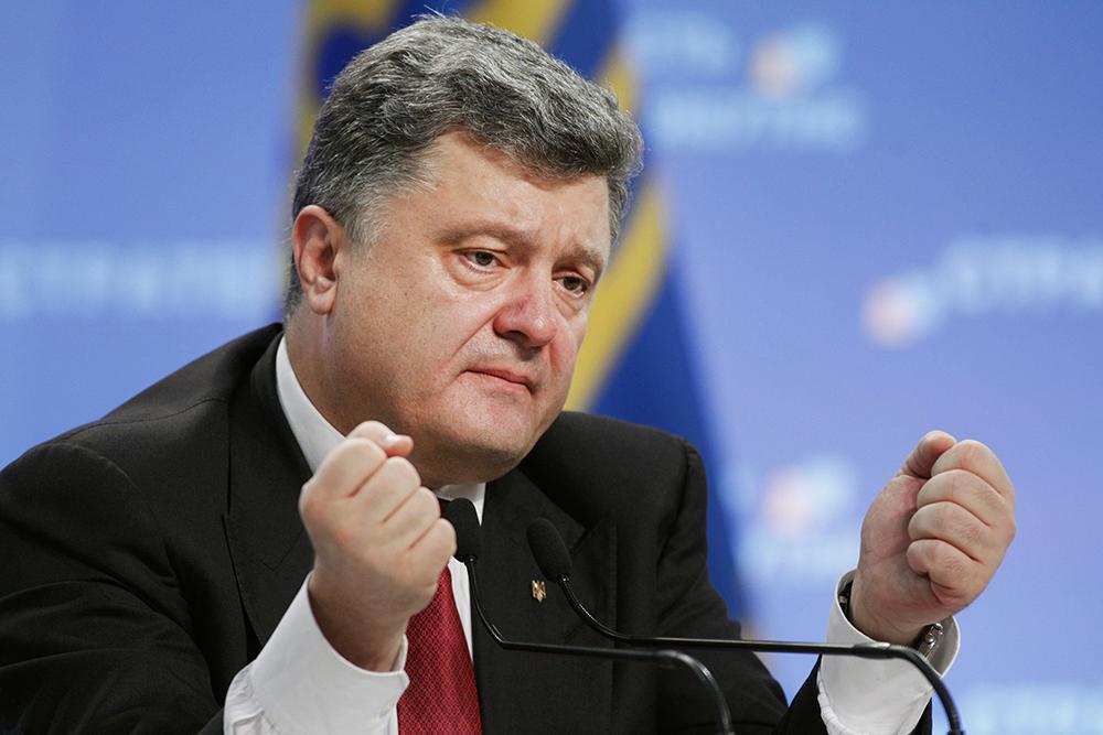 Ukraine's President Petro Poroshenko speaks to the media during a news conference in Kiev