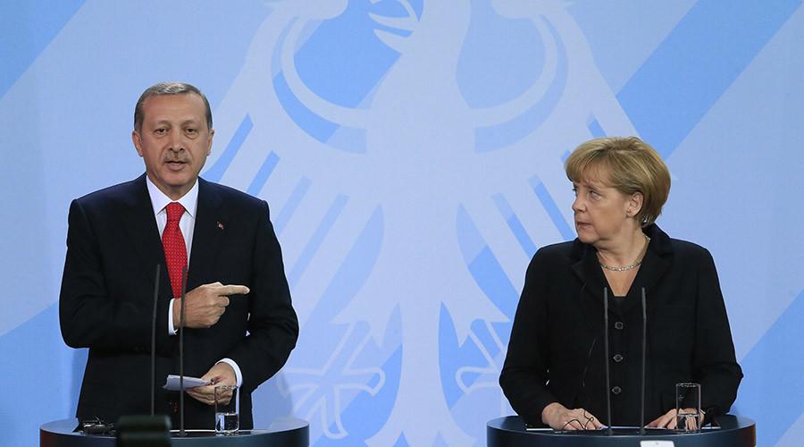 German Chancellor Merkel and Turkish Prime Minister Erdogan address media after talks in Berlin