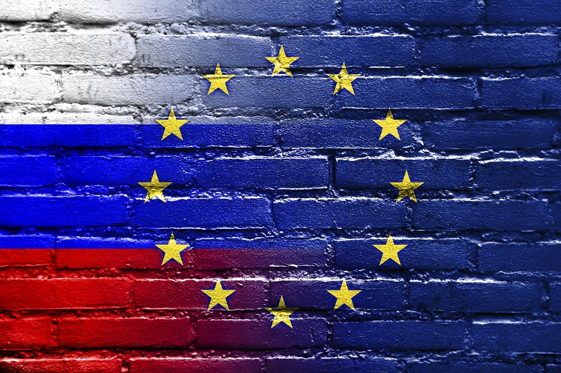 Russia and European Union Flag painted on brick wall