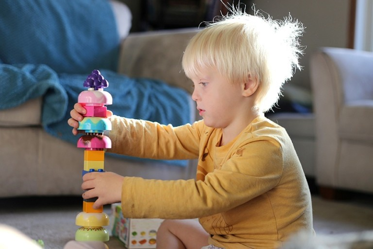 Young Preschool Child Stacking Building Blocks