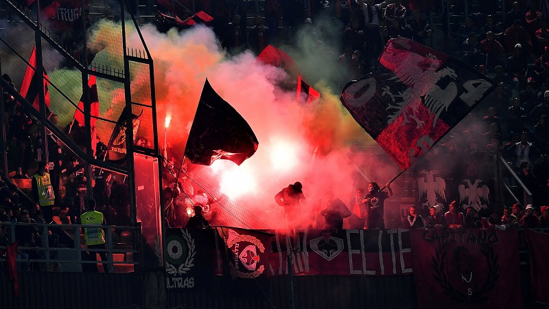 Albania's supporters light flares in the stands during the FIFA World Cup 2018 qualification football match between Italy and Albania on March 24, 2017 at Renzo Barbera stadium in Palermo.  / AFP PHOTO / ALBERTO PIZZOLI        (Photo credit should read ALBERTO PIZZOLI/AFP/Getty Images)
