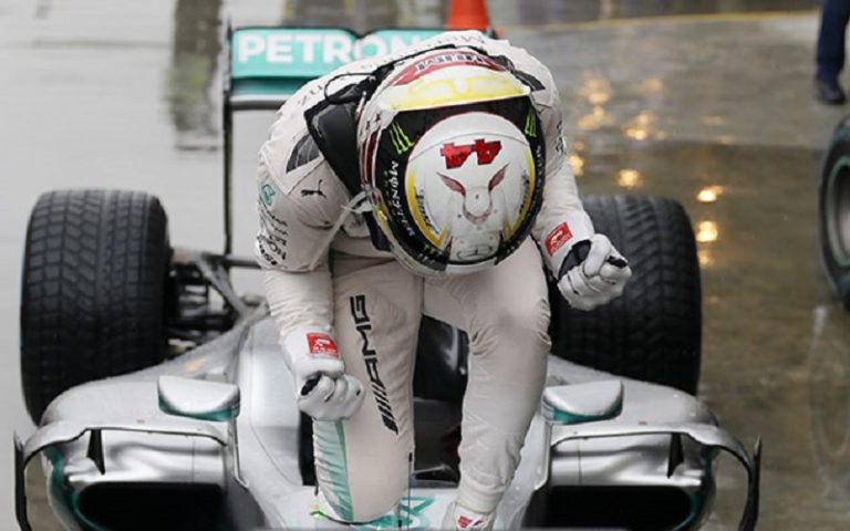 Mercedes driver Lewis Hamilton, of Britain, celebrates on his car after winning the Brazilian Formula One Grand Prix at the Interlagos race track in Sao Paulo, Brazil, Sunday, Nov. 13, 2016. (AP Photo/Nelson Antoine)