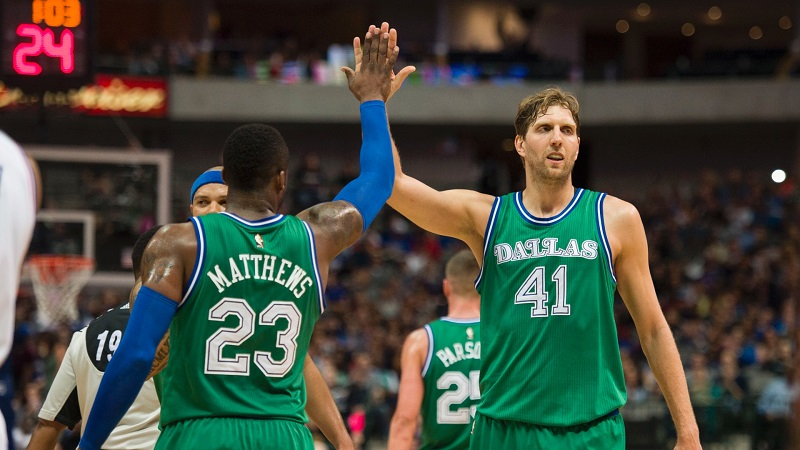 Feb 21, 2016; Dallas, TX, USA; Dallas Mavericks guard Wesley Matthews (23) and forward Dirk Nowitzki (41) celebrate during the first half against the Philadelphia 76ers at the American Airlines Center. Mandatory Credit: Jerome Miron-USA TODAY Sports