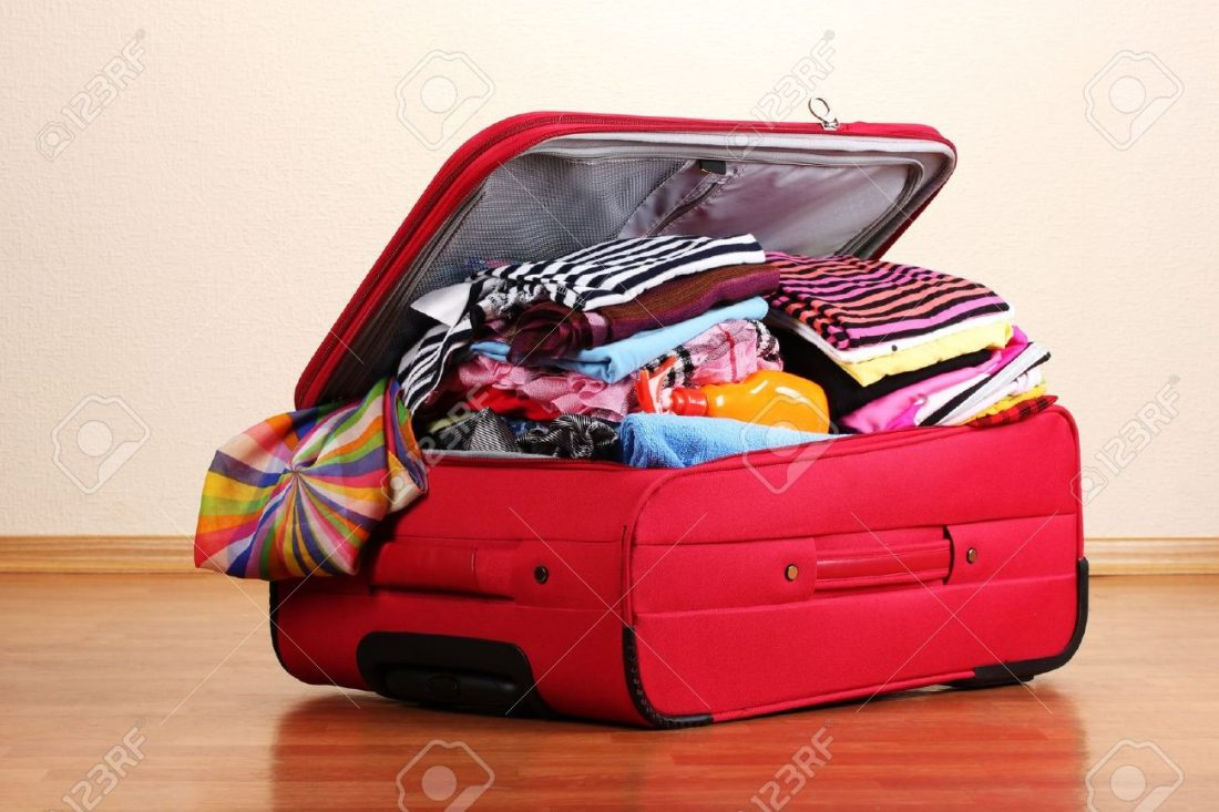 11411997-Open-red-suitcase-with-clothing-in-the-room-Stock-Photo-suitcase-travel-luggage